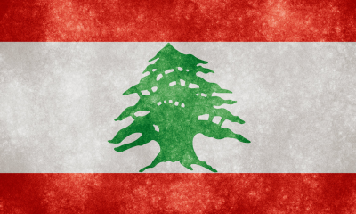 The flag of Lebanon by Header Image: Nicholas Raymond
