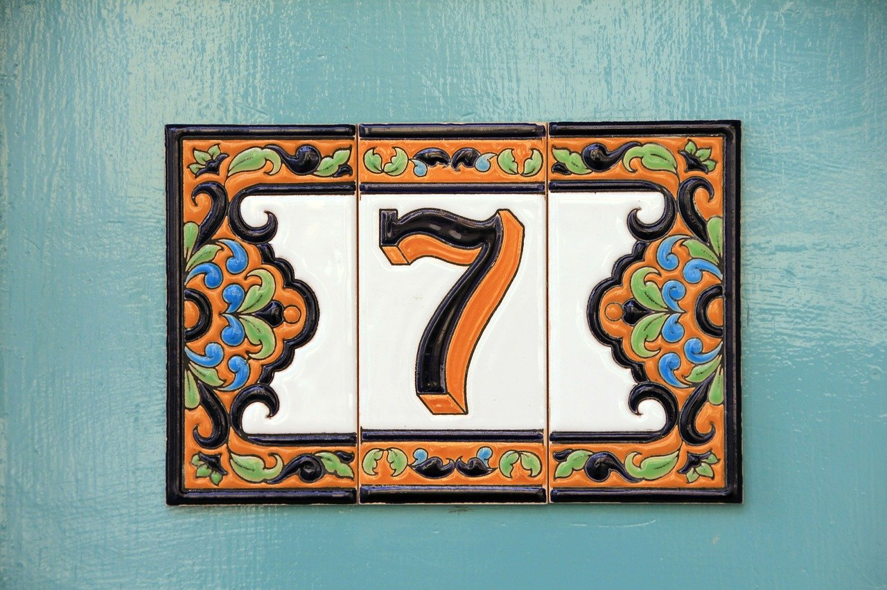 The number 7 on a tile on a door