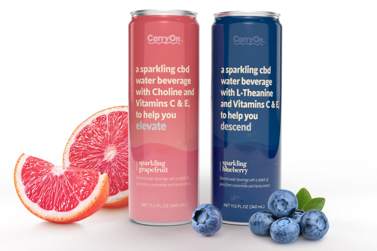 Two cans of sparkling water stand on a table
