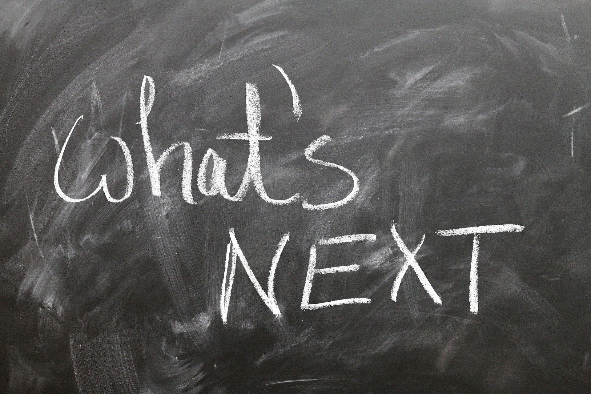 The words What's Next on a blackboard