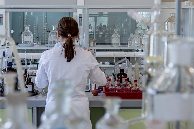 Scientist analyses samples in a lab