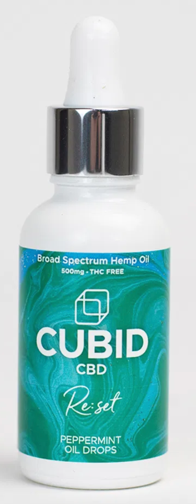 A bottle of peppermint Cubid CBD with a blue label