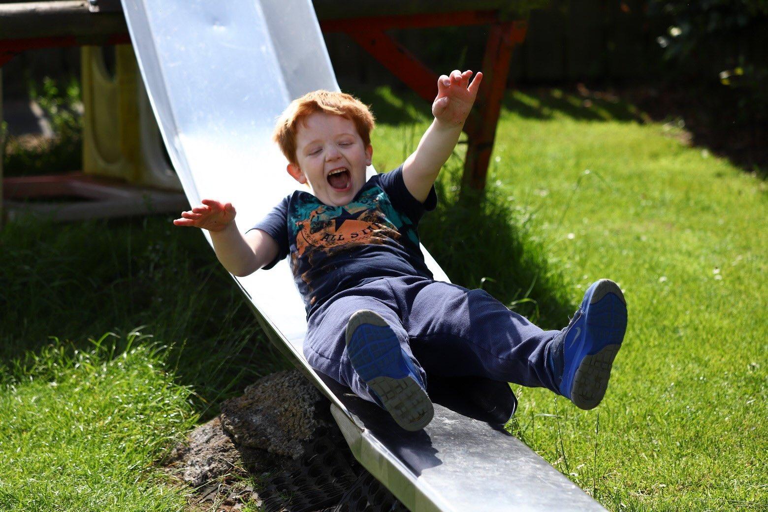 Little boy called Murray enjoyed a slide