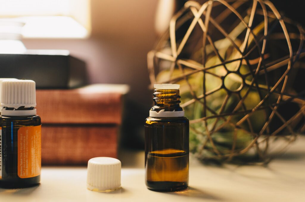 Image of two bottles of oil on a shelf