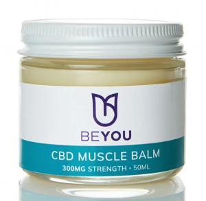 A CBD balm in a glass jar with a white lid