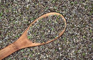 bag of hemp seeds with a wooden spoon