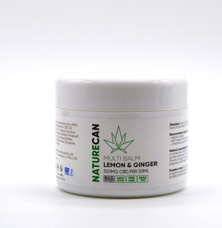 A white tub with green and black labelling that says Naturecan CBD Lemon and Ginger on it