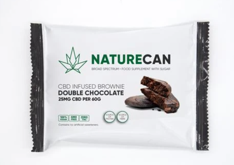 A white packet of brownie with NATURECAN written on it in green and black.