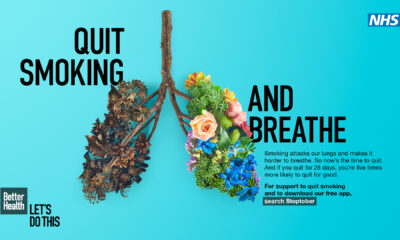 Blue background poster showing human lungs as part of NHS stop smoking campaign