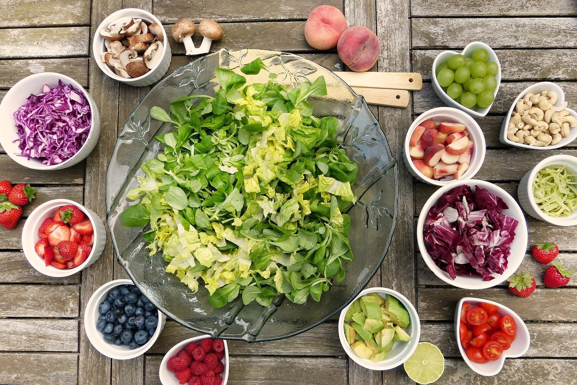 Healthy salad, vegetables on a wooden table