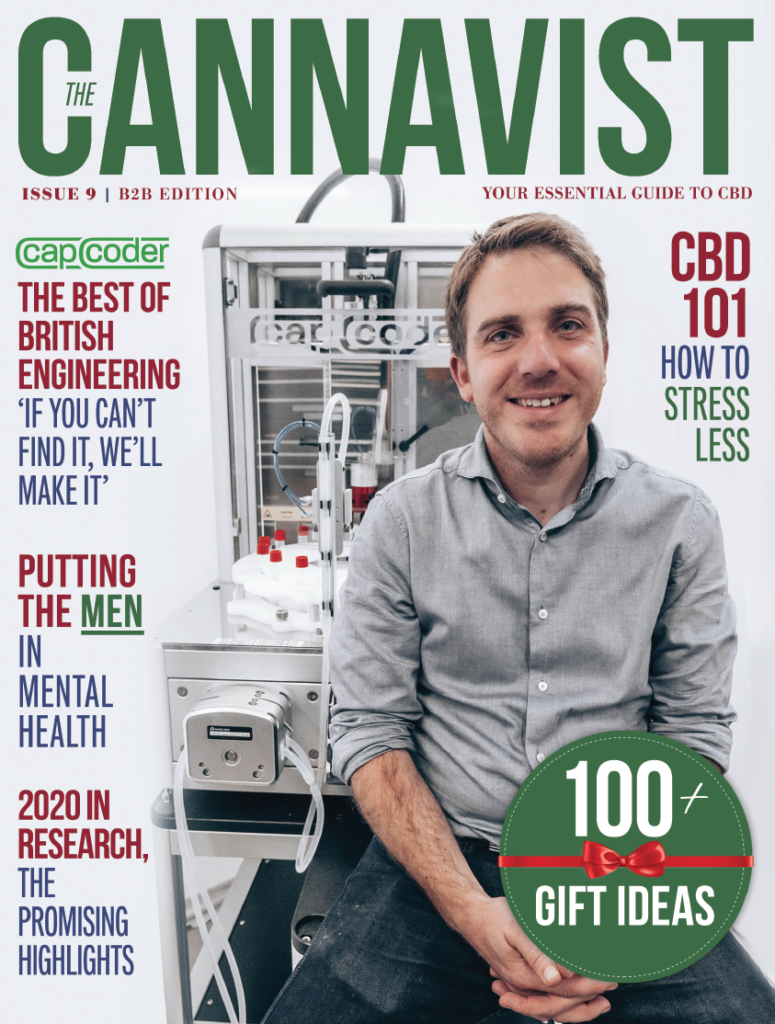 The cover of a magazine, with red, green and white colours features a man in a grey shirt and some text.