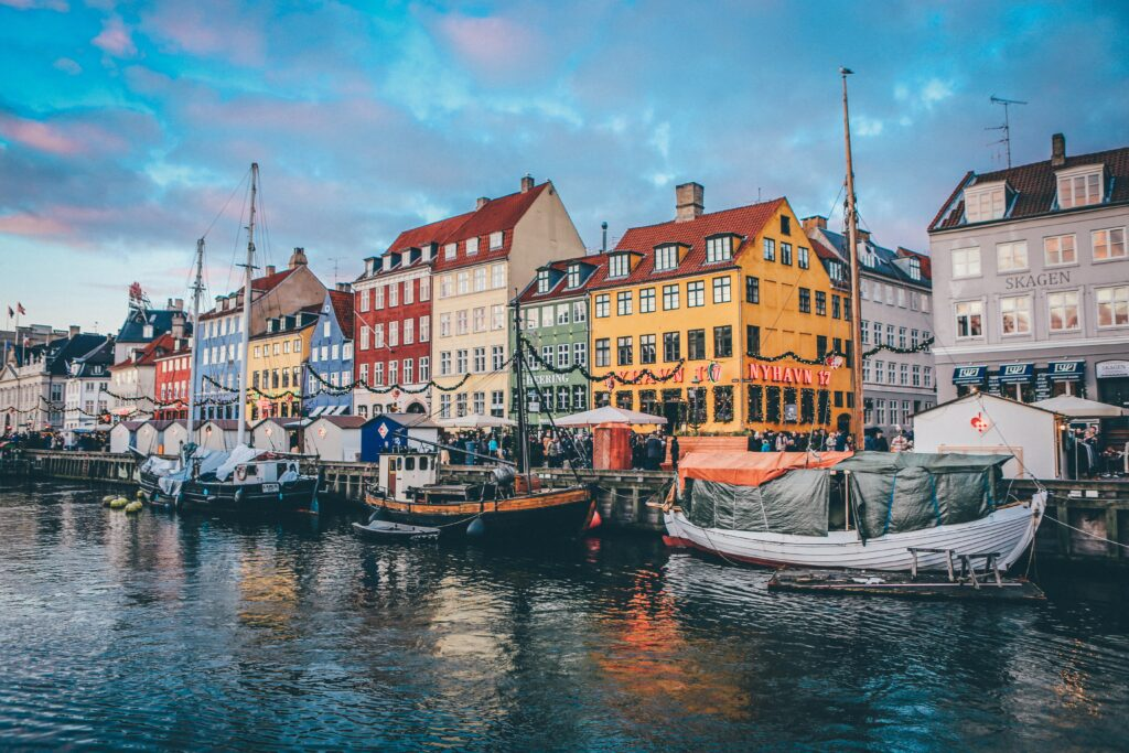 A shot of the colourful houses lining the main canal in Denmark and the boats there