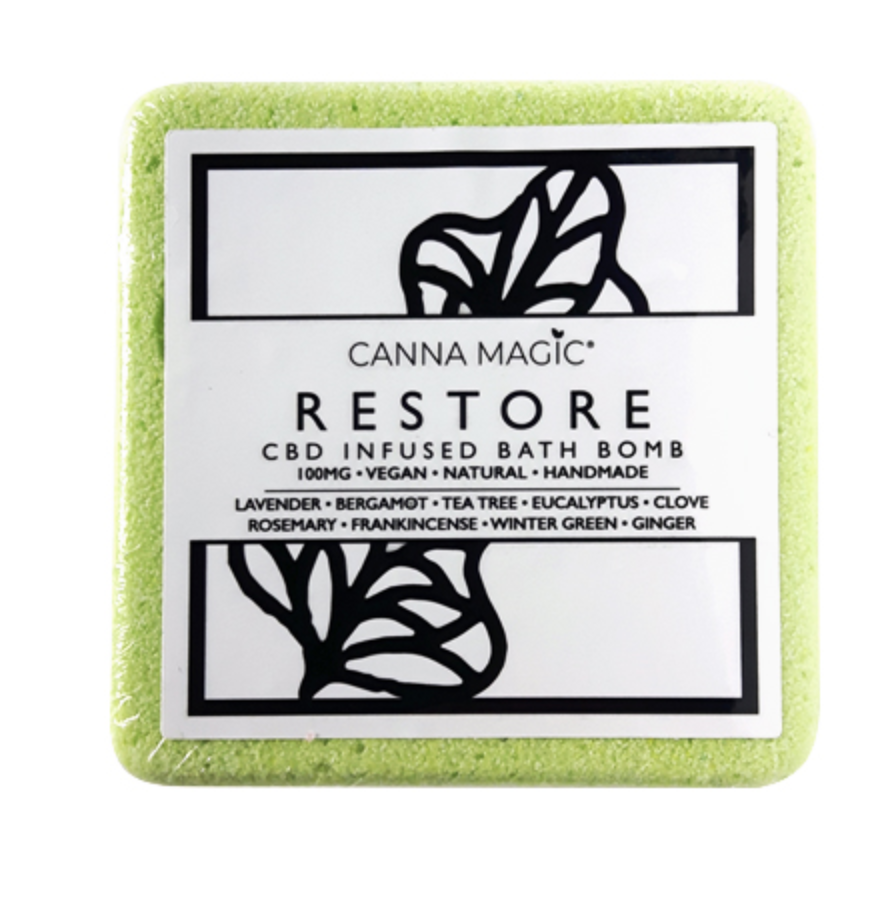 A green square bath bomb with RESTORE written in capital letters on the label from Canna Magic.