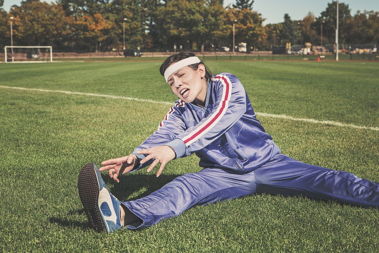 Woman in tracksuit stretching
