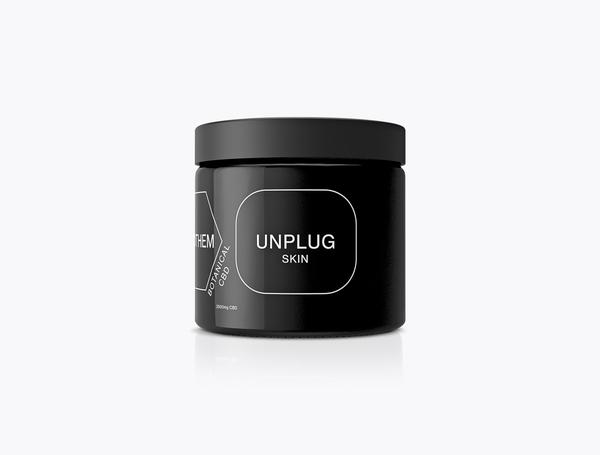 Black tub with black label and lid, with minimalistic white branding on the front and side.