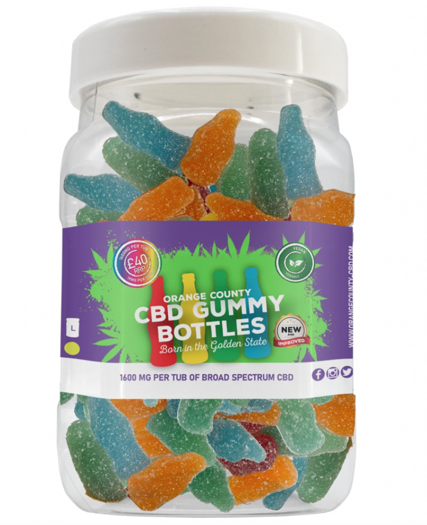 A clear plastic bottle of CBD edibles in cola bottle shapes