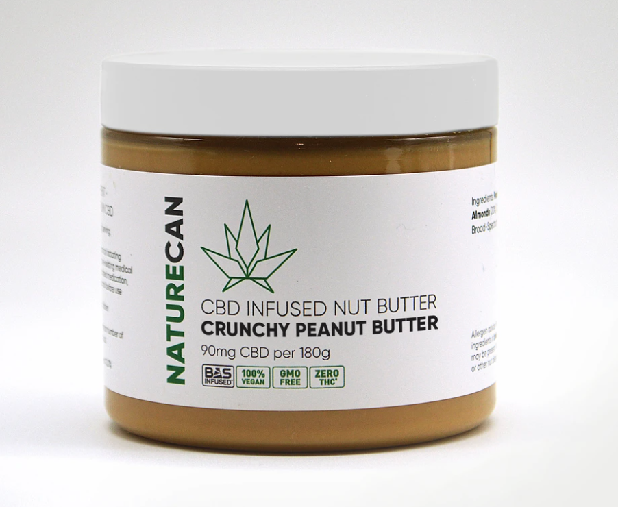 A white and brown jar of CBD infused nut butter from Naturecan