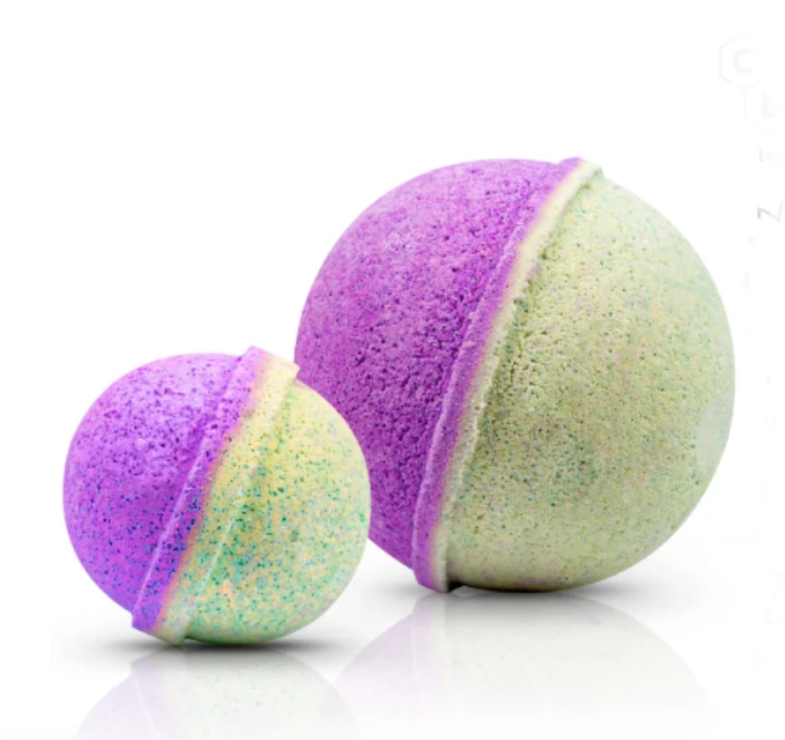 Two lime green and purple round bath bombs
